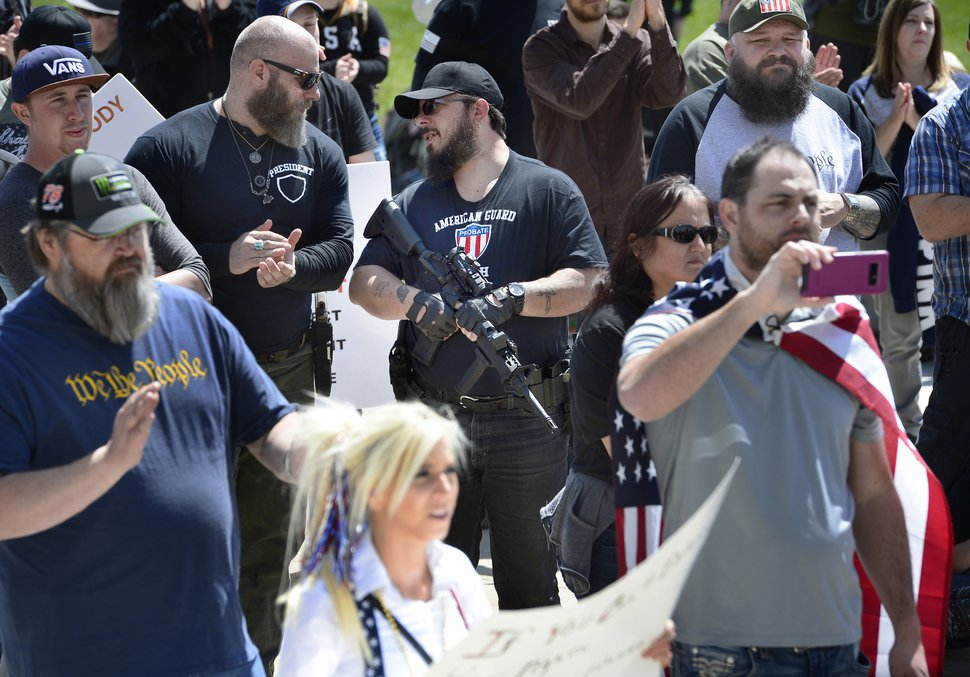 (Scott Sommerdorf | The Salt Lake Tribune) Two armed men talk as a group calling themselves Citizens and Students For Liberty (SFL) gathered at the Utah State Capitol on Saturday to show their support for the Second Amendment, Saturday, April 14, 2018.