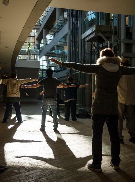 Lennie Mahler | The Salt Lake Tribune A group of homeless people practice tai chi at the Salt Lake City Public Library, Thursday, March 2, 2017.