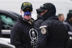 (Jacquelyn Martin | AP) People wearing hats and patches indicating they are part of Oath Keepers attend a rally at Freedom Plaza Tuesday, Jan. 5, 2021, in Washington, in support of President Donald Trump.