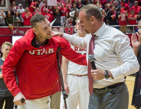 (Rick Egan | The Salt Lake Tribune) Utah Utes head coach Larry Krystkowiak hugs Utah Utes forward David Collette as he makes it back out on to the court to be honored on senior night. Collette was injured earlier in the game, in PAC-12 basketball action between Utah Utes and Colorado Buffaloes, at the Jon M. Huntsman Center, Saturday, March 3, 2018.