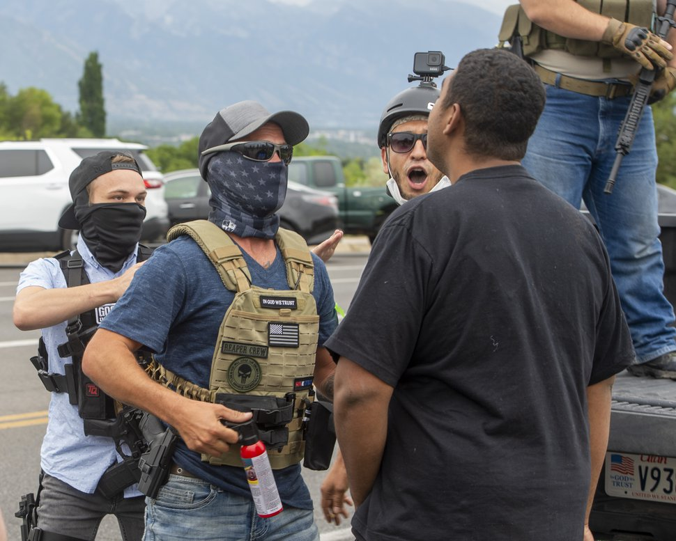 (Rick Egan | The Salt Lake Tribune) Counterprotesters threaten to spray mace on protesters during a face-off at the State Capitol grounds on Wednesday, July 22, 2020.
