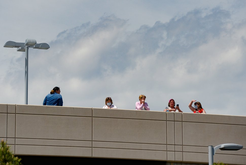 (Francisco Kjolseth | The Salt Lake Tribune) People gather on the rooftop of Intermountain Medical Center in Murray in anticipation of a flyover by the Air Force F-35A Lightning II Demonstration and 388th Fighter Wing, based at Hill Air Force Base, on Thursday, April 30, 2020. The demonstration over Utah was a