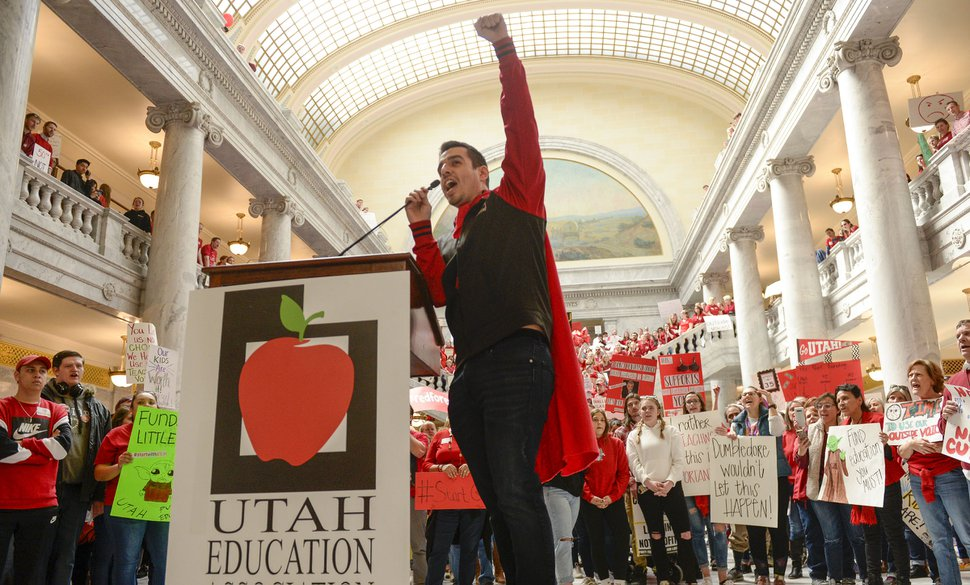 (Leah Hogsten | Tribune file photo) Franz Villate, a social studies teacher at Innovations High School leads the crowd in a