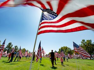 (Francisco Kjolseth     The Salt Lake Tribune) The Utah Healing Field marks the 19th anniversary of the 9/11 attacks, as as people visit the 1500 flags on the promenade outside Sandy City Hall on Friday, Sept. 11, 2020. This year the flags are spaced out more than they have in the past to allow for social distancing among people who visit the display.