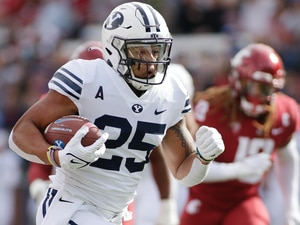 BYU running back Tyler Allgeier carries the ball during the first half of an NCAA college football game against Washington State, Saturday, Oct. 23, 2021, in Pullman, Wash. (AP Photo/Young Kwak)