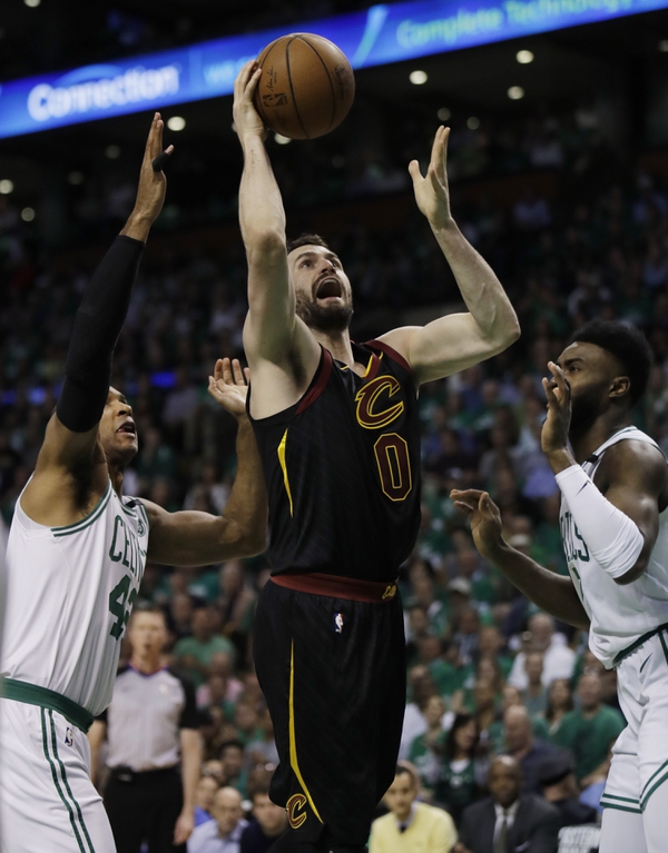 Cleveland Cavaliers center Kevin Love (0) goes up for a shot between Boston Celtics forward Al Horford, left, and guard Jaylen Brown during the first quarter of Game 5 of the NBA basketball Eastern Conference finals Wednesday, May 23, 2018, in Boston. (AP Photo/Charles Krupa)