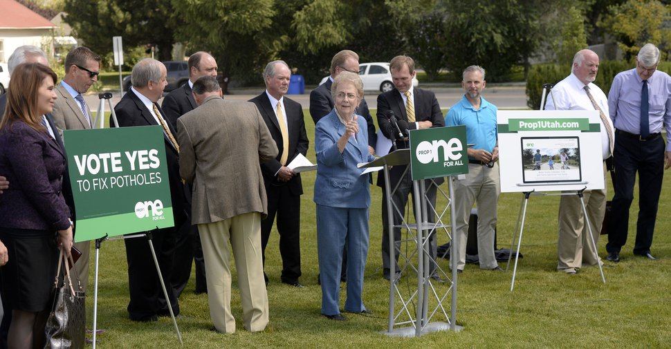 Al Hartmann | The Salt Lake Tribune Midvale Mayor JoAnn Seghini, center, gathers community leaders from northern together to start a press conference in Midvale Thursday August 27 to launch an