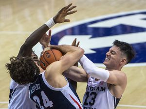 (Rick Egan | The Salt Lake Tribune)  Brigham Young Cougars guard Brandon Averette (4),and Alex Barcello (13), double-team Gonzaga Bulldogs forward Corey Kispert (24), in West Coast Conference Basketball action between the Brigham Young Cougars and the Gonzaga Bulldogs at the Marriott Center in Provo, on Monday, Feb. 8, 2021.