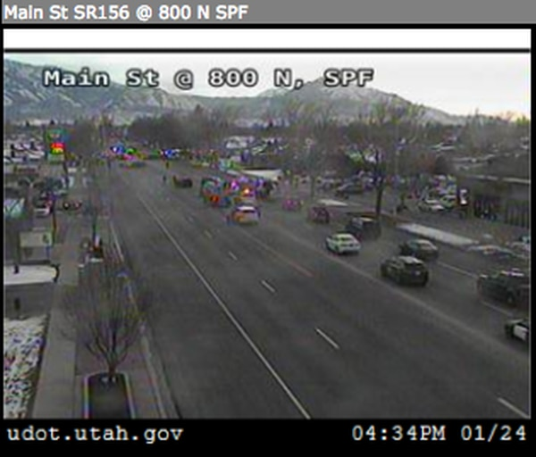 (Screenshot from the Utah Department of Transportation website) Police on scene in Spanish Fork during the arrest of Justin Llewelyn, wanted for a shooting in Riverton on Saturday.