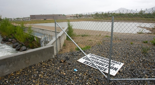 (Al Hartmann | The Salt Lake Tribune) A fence stands around the empty lot of the former Cottonwood Mall in Holladay in this 2011 file photo.