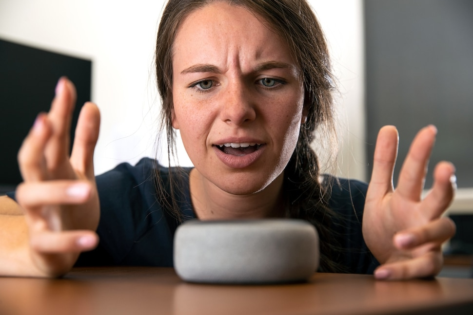 (Photo courtesy of Jaren Wilkey with Brigham Young University) Pictured is a woman jokingly yelling at Amazon's Alexa.