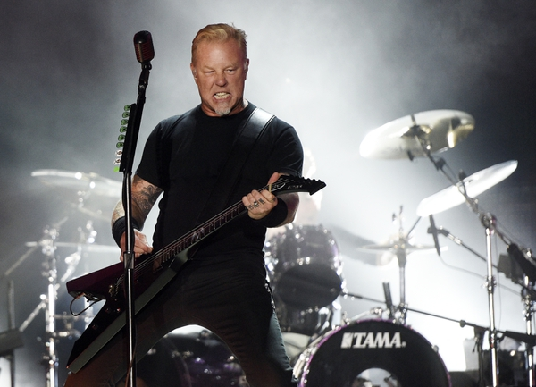 FILE - In this July 29, 2017, file photo, James Hetfield of Metallica performs during the band's concert at The Rose Bowl in Pasadena, Calif. Metallica and Dave Matthews are headlining a wildfire relief concert on Nov. 9, 2017, in San Francisco. (Photo by Chris Pizzello/Invision/AP, File)