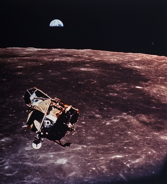 (AP Photo/NASA) The Apollo 11 Lunar Module ascent stage is photographed from the command service module during rendezvous in lunar orbit, July 20, 1969. The large dark colored area in the background is Smith's Sea. The Earth rises above the lunar horizon.