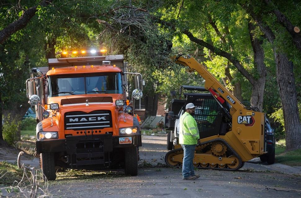 (Rick Egan | The Salt Lake Tribune) UDOT crews clean up tree waste from residents yards on Nocturne street in Rose Park onThursday, Sept. 10, 2020.