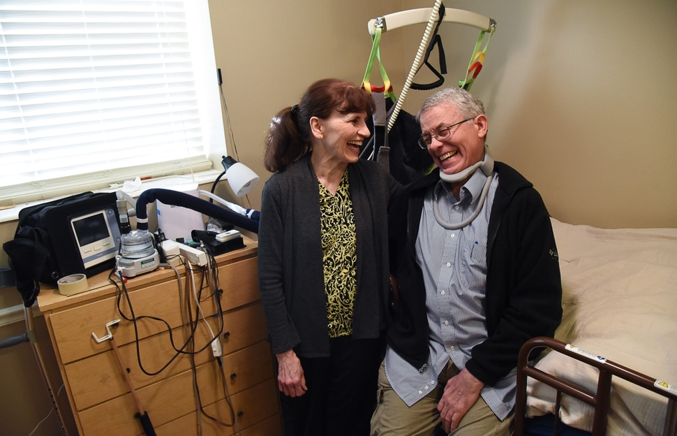 (Francisco Kjolseth | The Salt Lake Tribune) Rosie and Mark Sargeant share a laugh in his Orem basement bedroom, where a specialized bed and lift have been installed to help him after being diagnosed with ALS two years ago. Mark, who has endured it all with unbreakable humor, also knows that Rosie has taken on the excruciating role of caregiver.