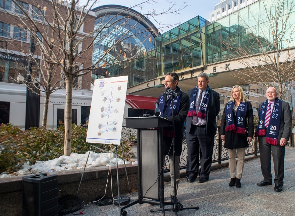 (Rick Egan | The Salt Lake Tribune) Derek Miller, president and CEO of the Salt Lake Chamber and Downtown Alliance, speaks as officials celebrate the 20th anniversary of TRAX trains during a news conference at the City Creek Trax stop on Main Street in Salt Lake City, Wednesday, Dec. 4, 2019.