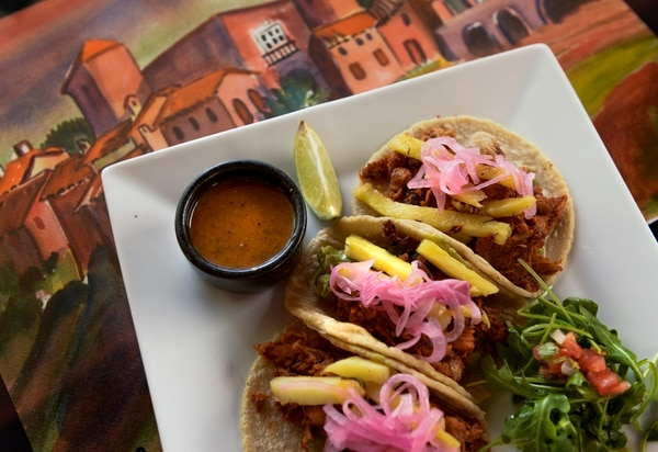 (Leah Hogsten   The Salt Lake Tribune) Rico Cocina y Tequila Bar's al pastor tacos with pork, grilled pineapple, grilled onion, cilantro and salsa.