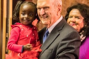 (Photo courtesy LDS Church) LDS President Russell M. Nelson holds a young girl from Zimbabwe's Mormon community during a stop in the southern Africa nation Tuesday. Nelson's wife, Wendy, also is pictured.