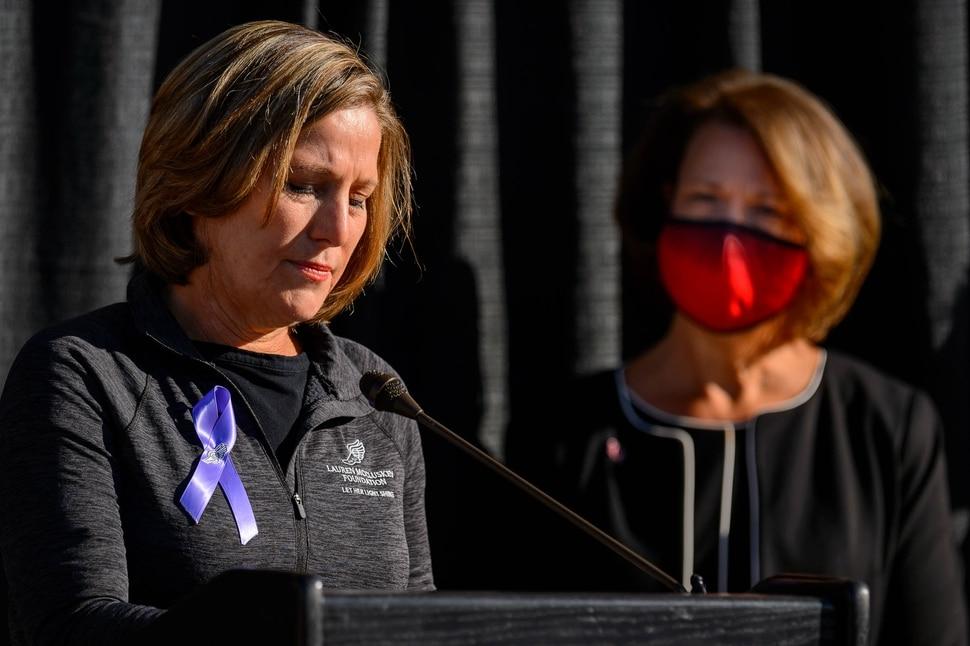 (Trent Nelson | The Salt Lake Tribune) Jill McCluskey speaks as the family of Lauren McCluskey announces a settlement of their lawsuit against the University of Utah, in Salt Lake City on Thursday, Oct. 22, 2020. University of Utah President Ruth Watkins is at right.
