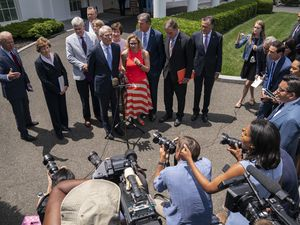 (Evan Vucci | AP) President Joe Biden, with a bipartisan group of senators, including Utah's Mitt Romney, speaks Thursday June 24, 2021, outside the White House in Washington. Biden invited members of the group of 21 Republican and Democratic senators to discuss the infrastructure plan.