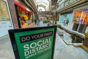 (Trent Nelson  |  Tribune file photo) A sign encouraging social distancing at City Creek in Salt Lake City on Tuesday, Nov. 24, 2020. A bill that advanced in the Utah Senate on Tuesday would create a $30 million fund to help small businesses struggling from the pandemic.