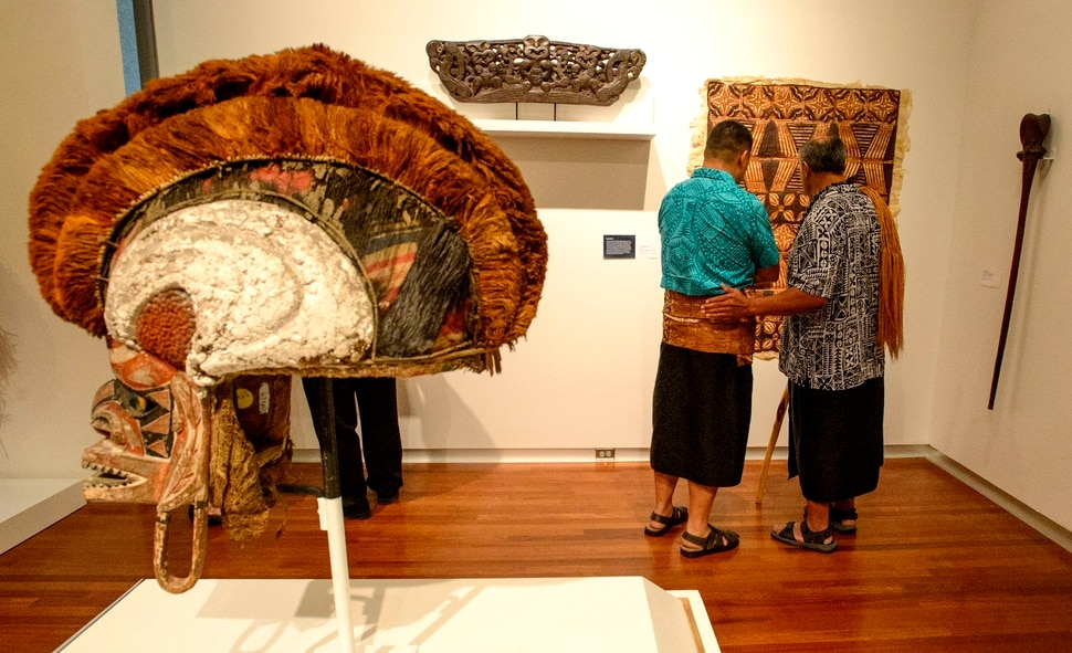(Steve Griffin | The Salt Lake Tribune) Members of Salt Lake City's Pacific Islander community enjoy the Arts of the Pacific gallery in the newly renovated Utah Museum of Fine Arts prior to blessing the collection in Salt Lake City Tuesday August 8, 2017. Elders from the local Maori and Samoan communities performed ceremonial dances, chants and oration to welcome the objects back on view and to thank Museum staff for continued care of their cultural objects.