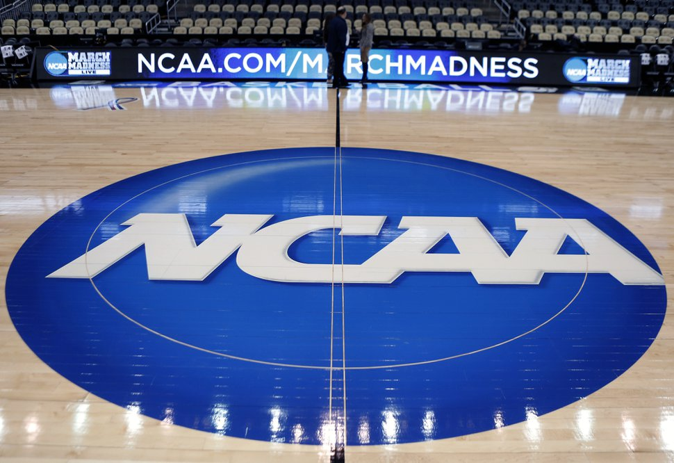 (Keith Srakocic | AP file photo) The NCAA logo is displayed at center court as work continues at The Consol Energy Center in Pittsburgh, for the NCAA college basketball tournament in 2015.