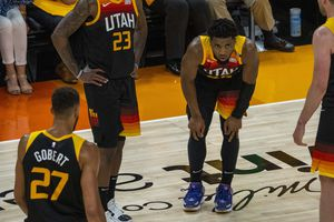 (Rick Egan | The Salt Lake Tribune) Utah Jazz guard Donovan Mitchell (45) is slow getting to his feet after being fouled by LA Clippers guard Paul George (13) in Game 2 of the Western Conference Semifinals at Vivint Arena, on Thursday, June 10, 2021.