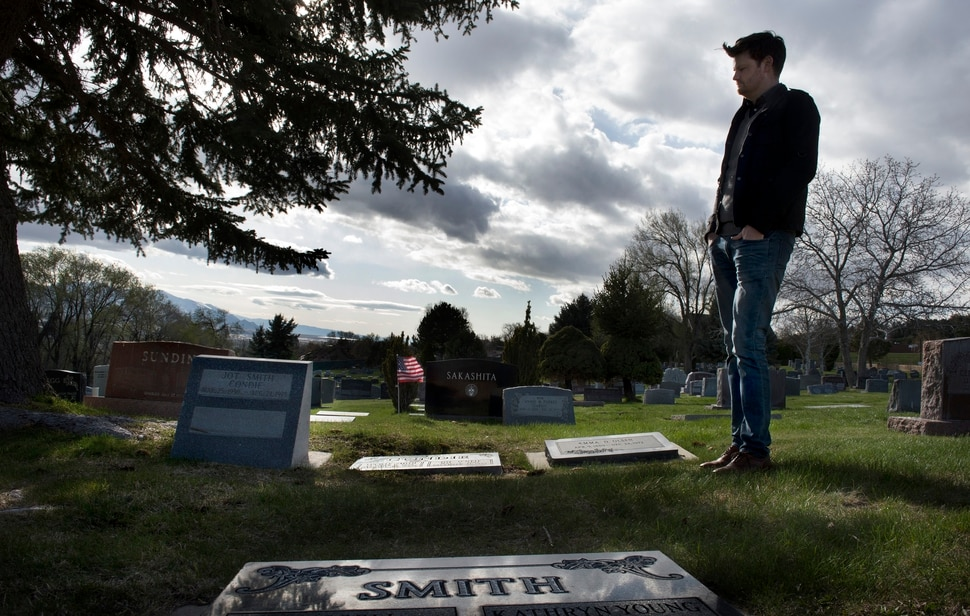 (Scott Sommerdorf | The Salt Lake Tribune) City Councilman Chris Wharton, who represents the area around the Salt Lake City Cemetery, visits the graves of great uncle, and great grandparents, Friday, April 13, 2018. Wharton is involved in an effort to help get more funding for the renewal of the cemetery.