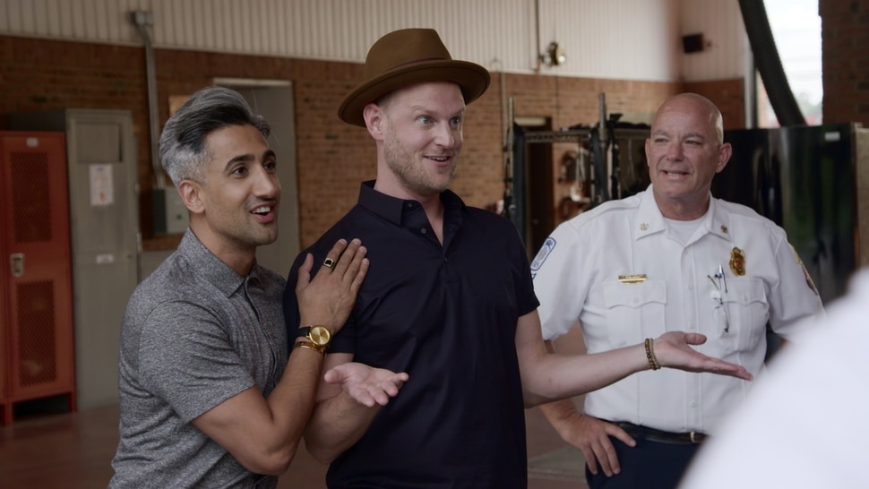 "(Photo courtesy of Netflix) Tan France, Bobby Berk and the fire chief in the ""Hose Before Bros"" episode of ""Queer Eye."""