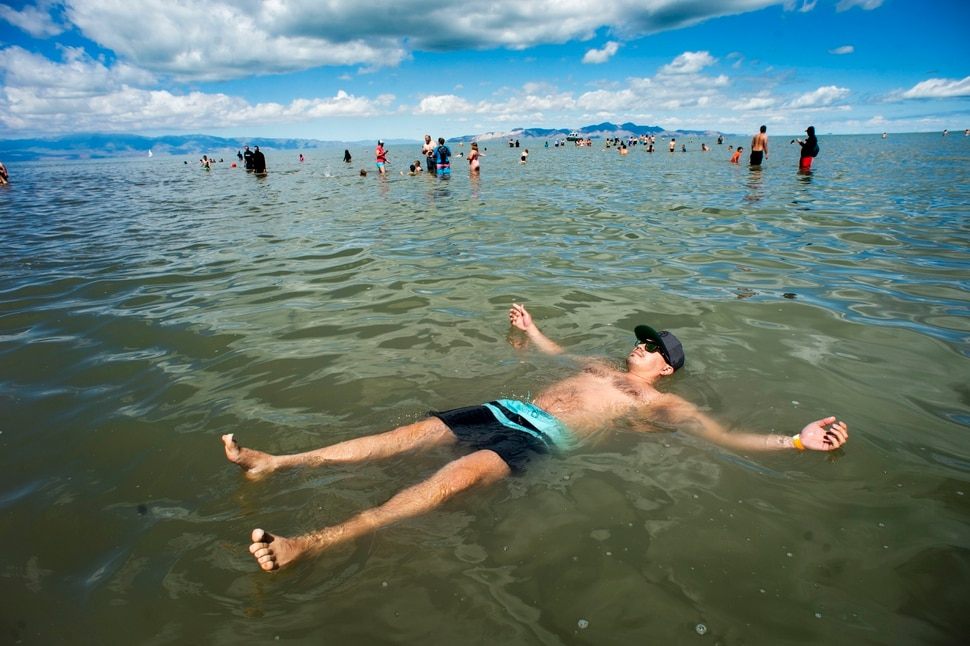 (Rick Egan | The Salt Lake Tribune) Mikal Kelaitis, floats in the Great Salt Lake during an attempt to beak the record for most people floating at one time, Saturday morning, June 8, 2019. The attempt to break the record was turned-on to a polar plunge, because of the cool temperatures.
