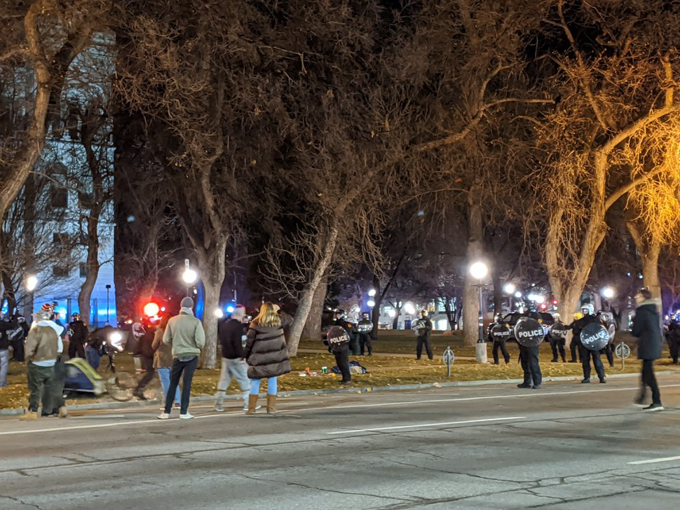 (Paighten Harkins | The Salt Lake Tribune) Protesters and onlookers watch as Salt Lake City police move in on a group of protesters occupying Washington Square Park on Sunday, Jan. 5, 2020.