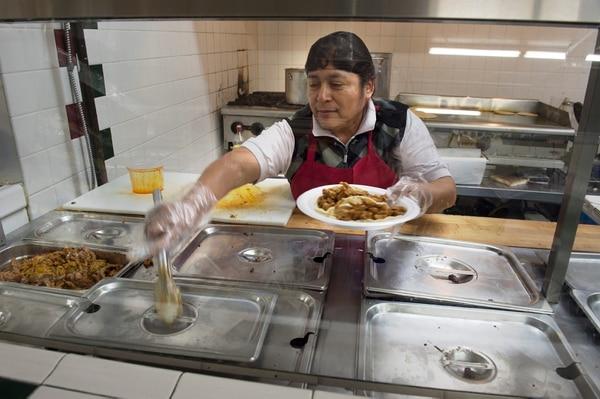 (Scott Sommerdorf | The Salt Lake Tribune) Lucia Flores prepares a dish of tacos at Anaya's Market, 1490 Munchkin Road.