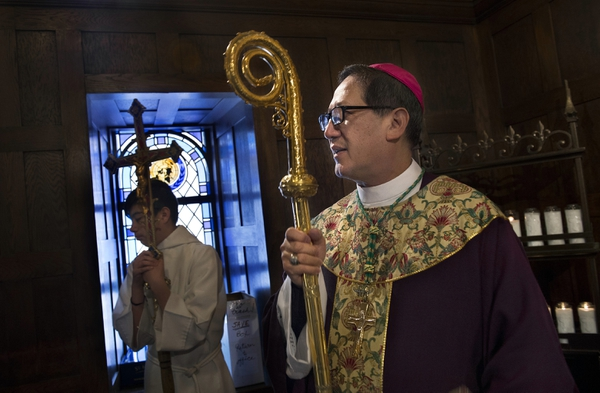 Catholic Bishop Oscar A. Solis waits in an anteroom prior to leading the Mass on the third Sunday of Lent, Sunday, March 4, 2018. March 7 marked his first anniversary of his installation as the 10th bishop of Salt Lake City. (Scott Sommerdorf /The Salt Lake Tribune via AP)