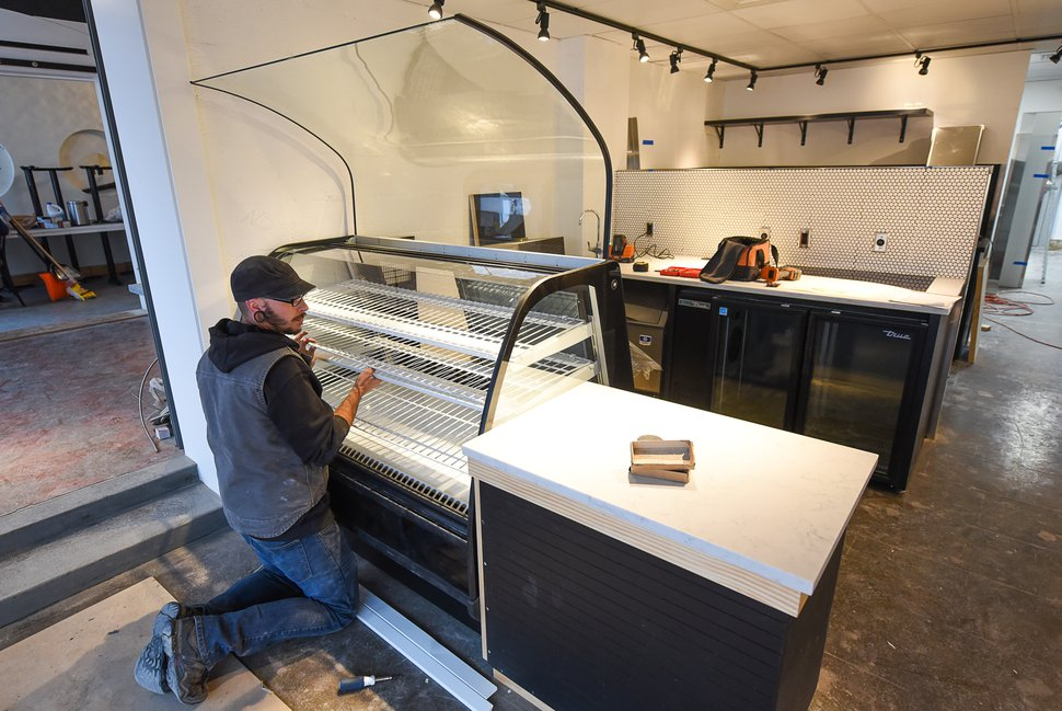 (Francisco Kjolseth | The Salt Lake Tribune) Cameron Isaac works on the final details at Stratford Proper, the fourth sibling in the Proper chain (along with Proper Brewing, Avenues Proper and Proper Burger), which opens Dec. 10 at 1588 E.Stratford Ave. It's in the old Per Noi Italian restaurant space.