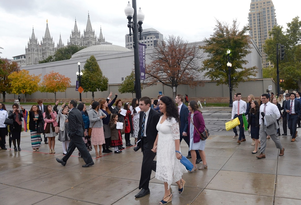(Al Hartmann | The Salt Lake Tribune) Members of the Church of the Jesus Christ of Latter Day Saints walk to the General Conference Oct. 1 2017.
