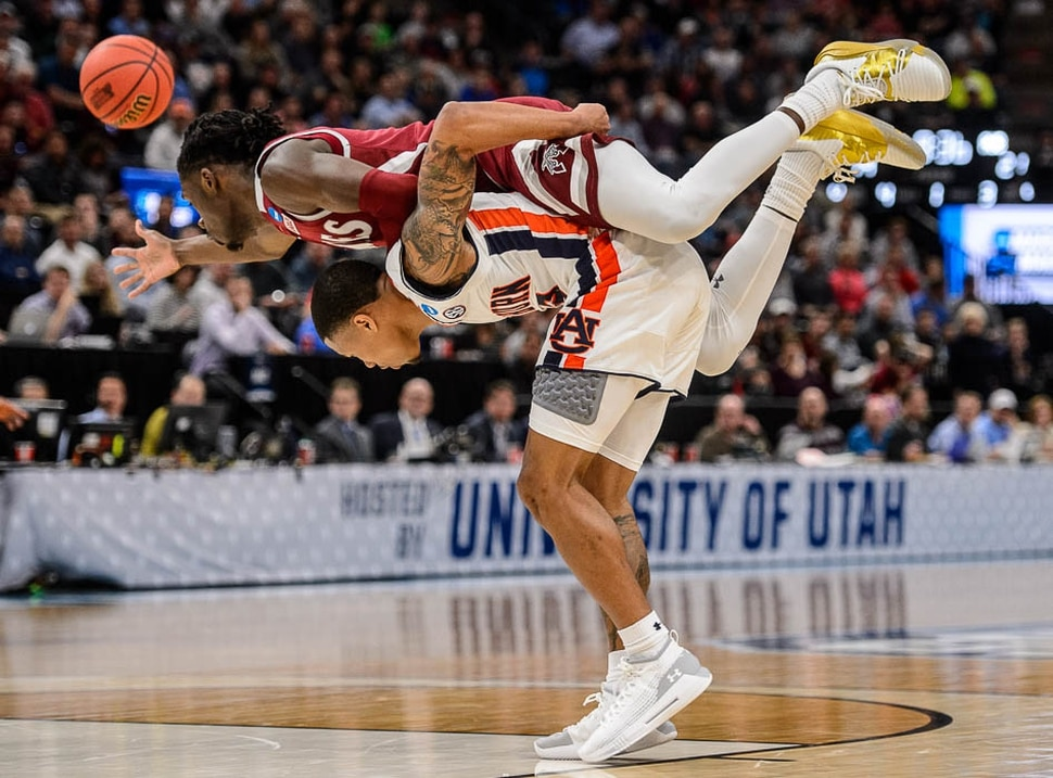 (Trent Nelson | The Salt Lake Tribune) New Mexico State Aggies guard Clayton Henry (5) on top of Auburn Tigers guard J'Von McCormick (12) as Auburn faces New Mexico State in the 2019 NCAA Tournament in Salt Lake City on Thursday March 21, 2019.