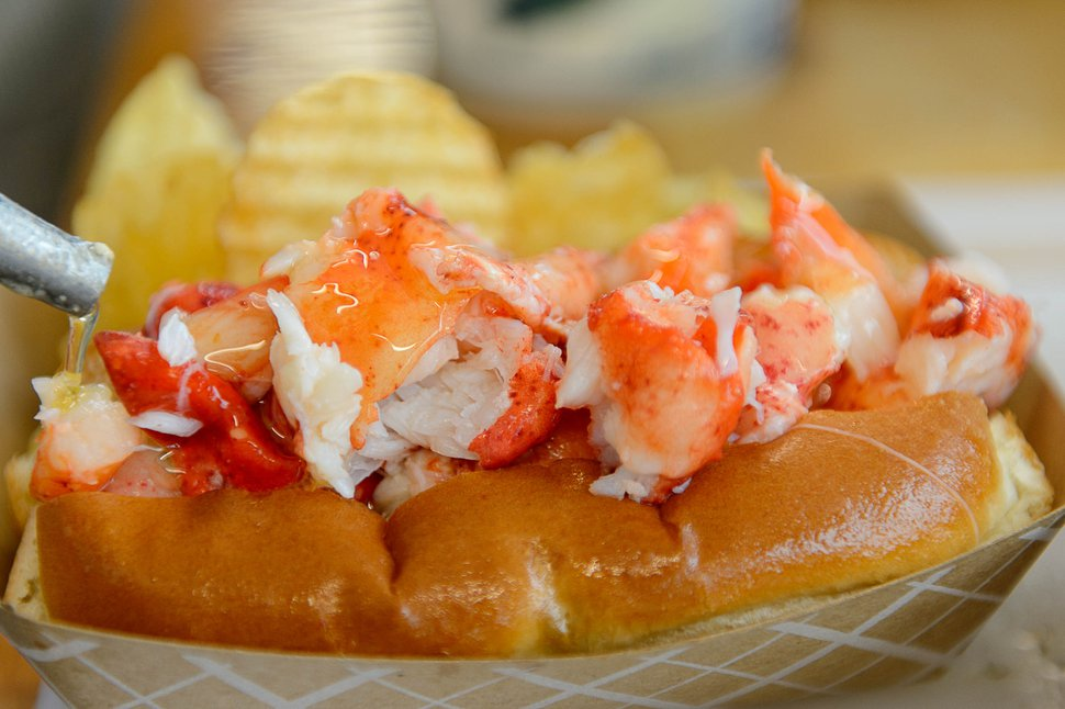 (Trent Nelson | The Salt Lake Tribune) A lobster roll gets a layer of hot butter at Freshie's Lobster Co. in Park City.