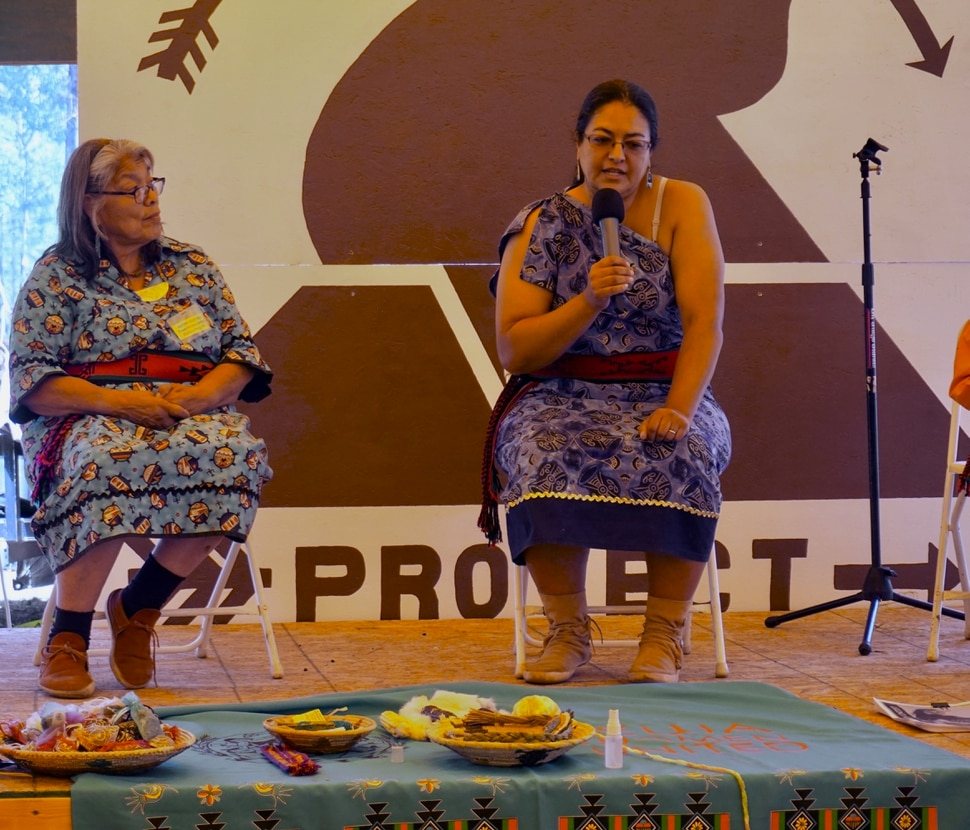 (Zak Podmore | The Salt Lake Tribune) Kathy Sanchez, left, and Beata Tsosie of Tewa Women United speak about the impacts of the Los Alamos National Lab on water quality in New Mexico, and their group's efforts to mitigate contamination through bioremediation. The women spoke at the fifth-annual Bears Ears Summer Gathering on July 20, 2019.