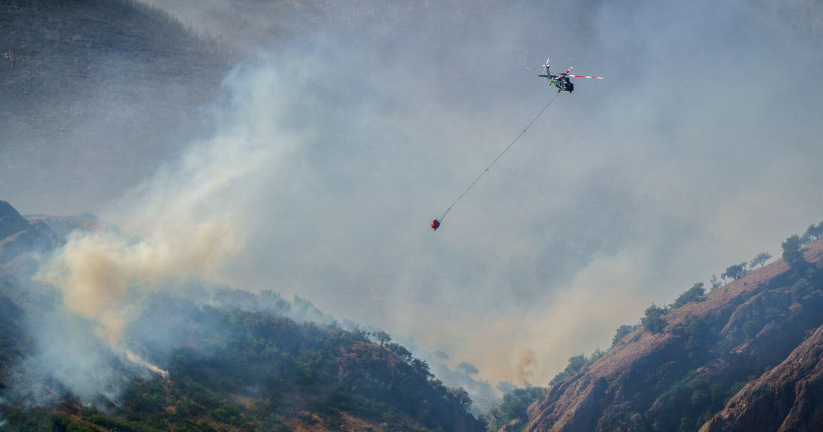 Utah wildfires grow overnight as winds and heat continue to slow firefighting