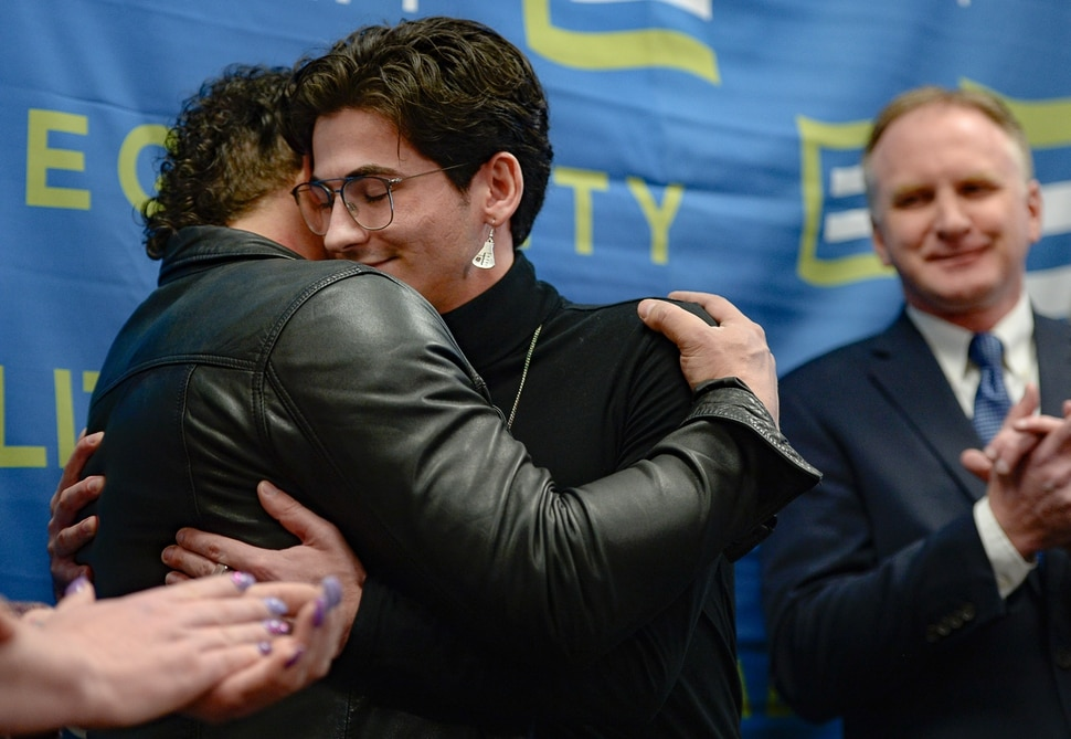 (Francisco Kjolseth | The Salt Lake Tribune) Justin Utley, left, and Nathan Dalley, both survivors of conversion therapy, embrace after Dalley spoke on his painful and harmful experiences that he considered the worst days of his life. Equality Utah held a press conference at the Utah Capitol on Wednesday, Jan. 22, 2020, to recognize Utah becoming the 19th state in the nation to enact a ban on conversion therapy for minors. At right is Rep. Craig Hall, R-West Valley, was the sponsor of the bill that helped prohibit conversion therapy.