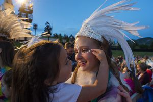 (Rick Egan  |  The Salt Lake Tribune)  Catalina Pickering, 3, from Saratoga Springs, is fascinated with the costume worn by 15-year-old, Bethany Christensen, 15, a Lamanite dancer, as the performers mix with the audience, before the Mormon Miracle Pageant Wednesday, June 12, 2019.  The final run for the pageant continues through Saturday, June 22.
