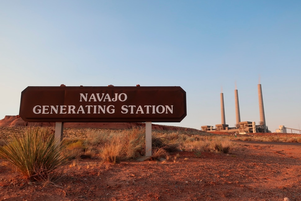 (Felicia Fonseca | AP file photo) The coal-fired Navajo Generating Station near Page, Ariz. is seen Aug. 19, 2019. The power plant will close before the year ends, upending the lives of hundreds of mostly Native American workers who mined coal, loaded it and played a part in producing electricity that powered the American Southwest.