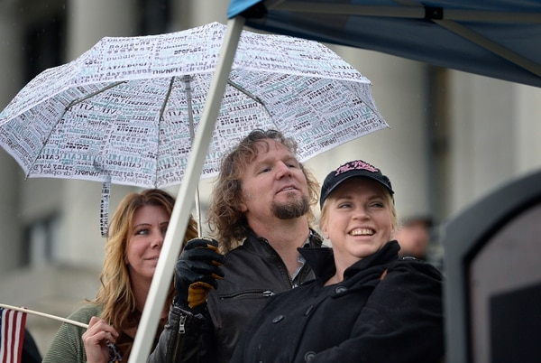 Scott Sommerdorf | The Salt Lake Tribune Polygamist Kody Brown listens to his wife Christine speak to polygamists and their supporters at a rally on the south steps of the Capitol, Friday, February 10, 2017.