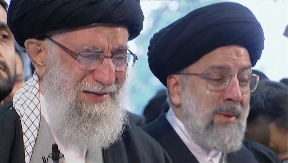 (Iran Press TV via AP) In this image taken from video, Iranian Supreme Leader Ayatollah Ali Khamenei, left, openly weeps as he leads a prayer over the coffin of Gen. Qassem Soleimani, who was killed in Iraq in a U.S. drone strike on Friday, at the Tehran University campus, in Tehran, Iran, Monday, Jan. 6, 2020.
