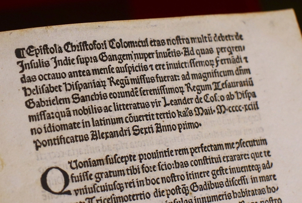 (Tony Gentile/Pool Photo via AP) A detail of a page of an authentic 15th-century copy of a letter written by Christopher Columbus as displayed at the Vatican, Thursday, June 14, 2018. The United States is returning to the Vatican Library a letter written by Christopher Columbus in 1493 announcing his discovery of the New World that was stolen and replaced with a forgery.