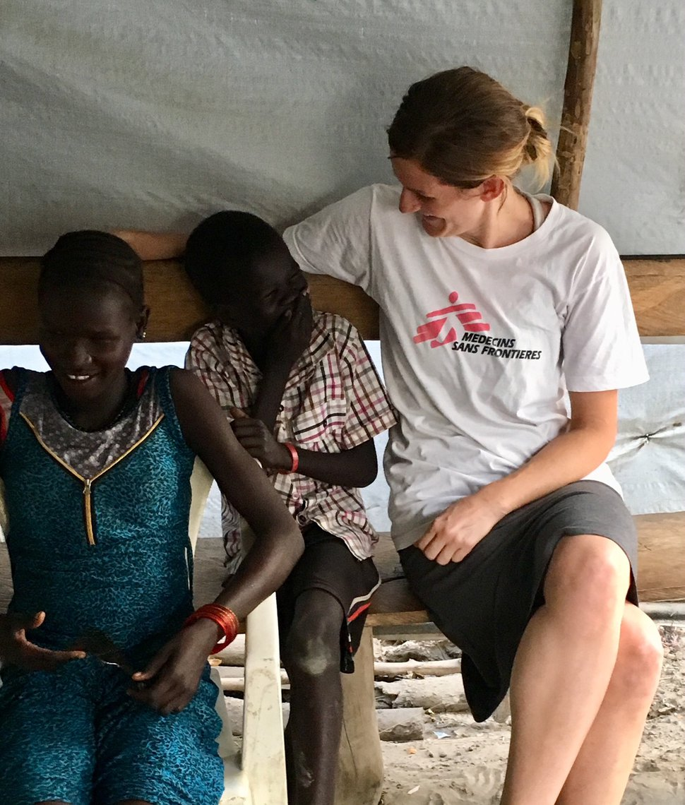 (Photo courtesy Doctors Without Borders) Kirsti Rinne jokes with some villagers during a break from her duties as director of a 24-bed maternity ward at the Doctors Without Borders hospital in the village of Lienkien in South Sudan.