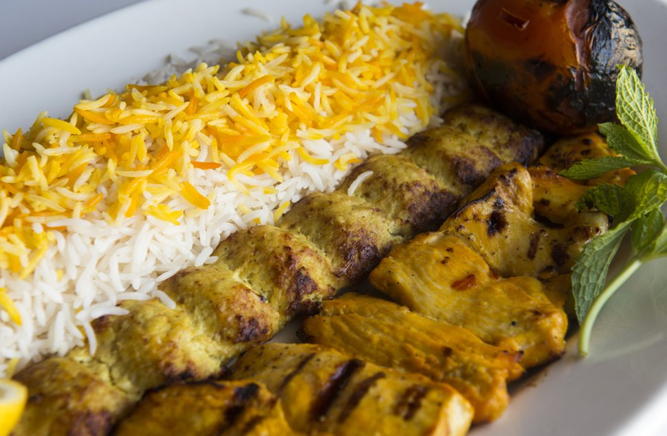 Rick Egan | The Salt Lake Tribune The Chicken Soltani plate: includes two chicken skewers (one ground chicken the other marinated and charbroiled) served with rice and grilled tomato at the Zaferan Cafe, in Cottonwood Heights, Monday, August 17, 2015.