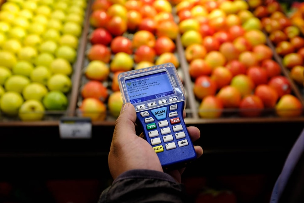 (Trent Nelson | The Salt Lake Tribune) Smith's has introduced handheld scanners to five Utah stores - where shoppers carry a small device and scan and bag their groceries as they walk through the aisles. Adrian Ortega demonstrated one of the units at the Rose Park store, Monday April 16, 2018.
