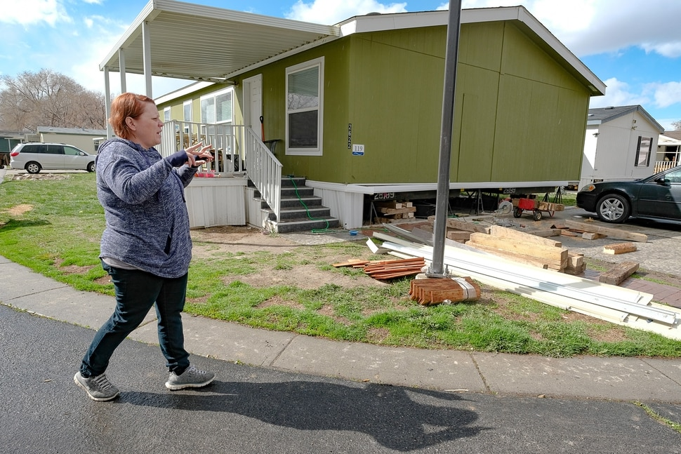 (Francisco Kjolseth | The Salt Lake Tribune) Celeste Tunno, a resident of the Western Estates mobile home park in Magna talks about some of the damage sustained to her home following last week's earthquake on Monday, March 23, 2020, as her husband risks shoring up their home with wood blocks despite continued aftershocks.